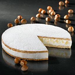 Tarta de requesón con un delicado relleno de pera entre dos crujientes galletas con almendra Bindi